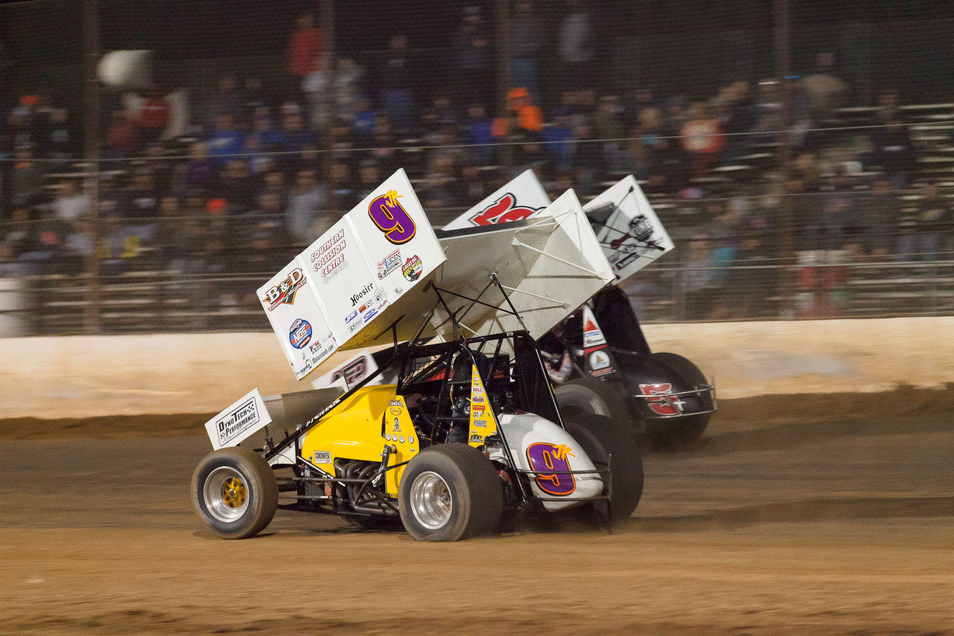 The 5T of Ryan Timms overtakes the 9JR of Derek Hagar going into turn 3 at Lake Ozark Speedway during the ASCS Sprint Car A Feature. (Jeffrey Turford / TDP)