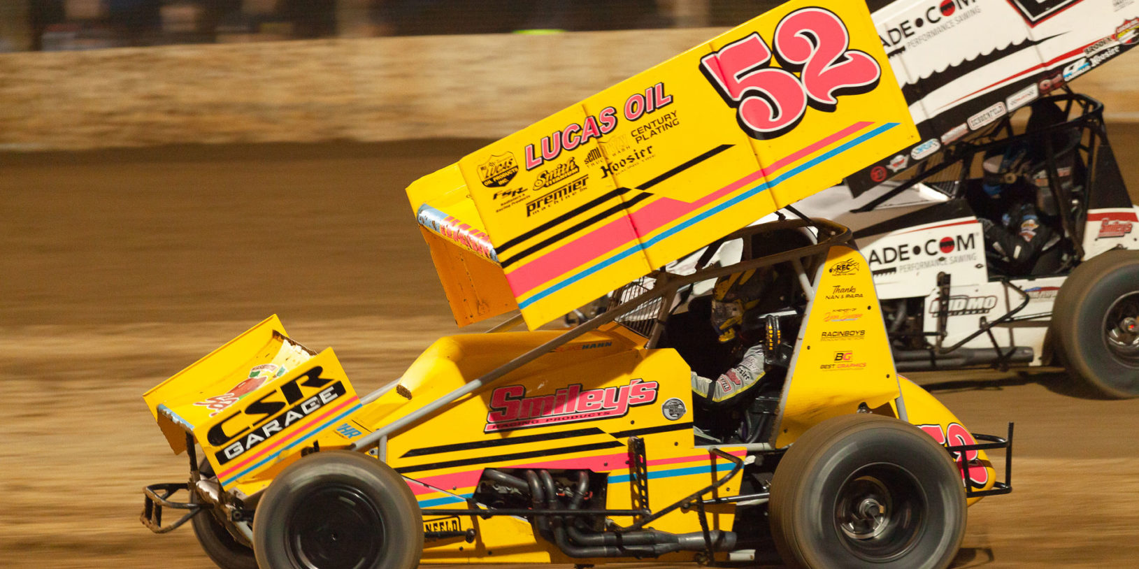 The 52 of Blake Hahn goes low through turn 2 and overtakes the 28 of Scott Bogucki during their heat race at Lake Ozark Speedway for the 2021 Memorial Weekend Sprint and Midget Nationals presented by The Drivers Project. ( Jeffrey Turford / TDP )